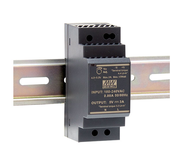 Low profile, stepped front DIN rail power supply